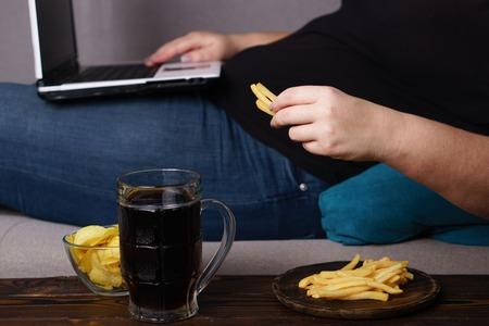 Lonely woman watch series drink beer eat junk food