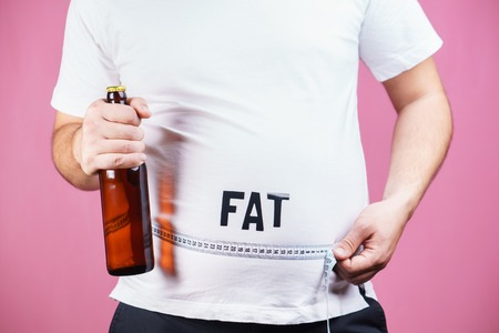 overeat, estrogen level,glutton, alcohol addiction Stock Photo