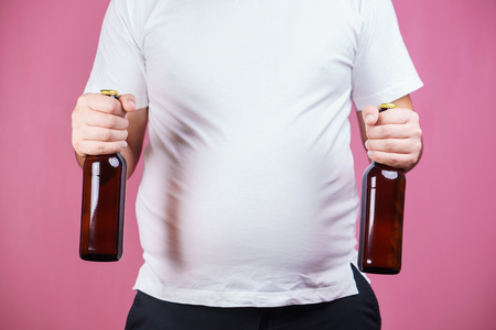 beer belly, alcoholic addiction. fat man with beer Stok Fotoğraf