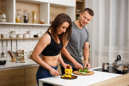 health conscious couple cooking low calorie dinner