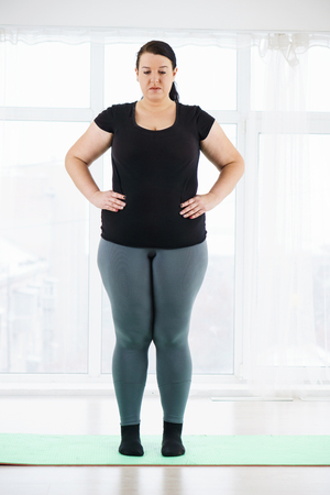 young plus size woman before home workout