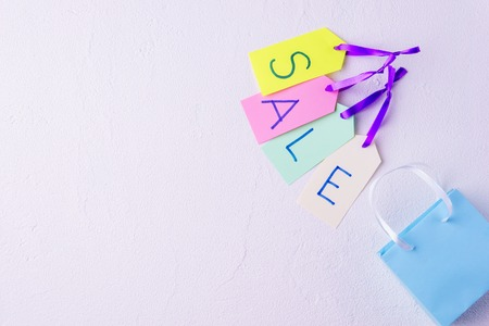 sale banner with shopping bag and price tags 写真素材