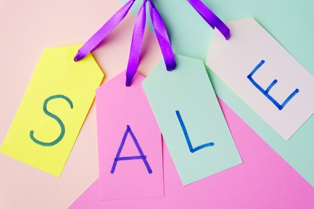 spring sale, price tags on pastel background