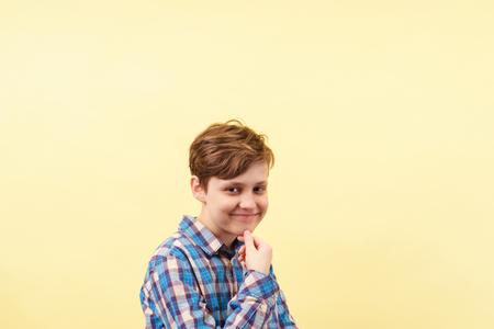 smug cheeky daring boy with skeptical smile