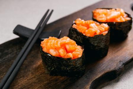 Seafood delicatessen salmon gunkan maki sushi roll