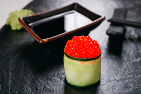 Tobiko caviar topped sushi roll with cream cheese