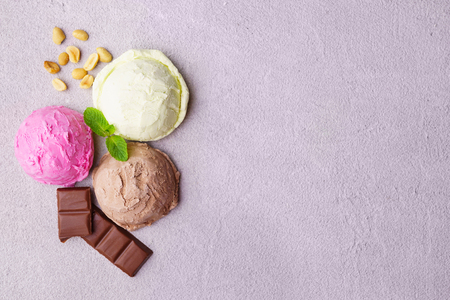Three various ice cream balls, summer refreshment