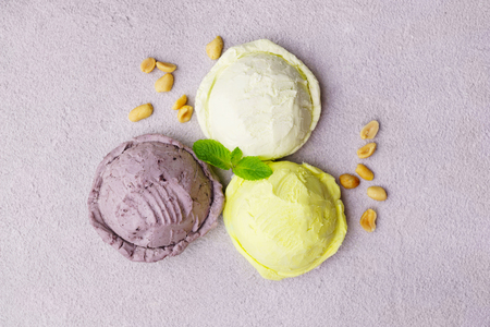 Three various ice cream balls, summer refreshment