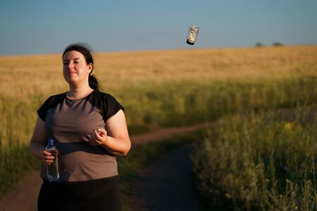Overweight woman throw out slimming pills