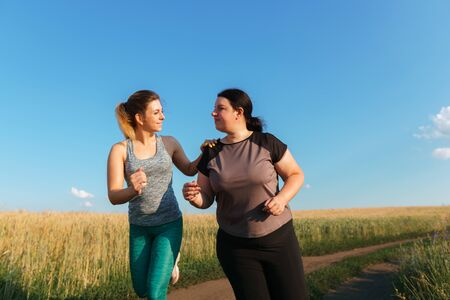fit woman support and motivate friend at workout