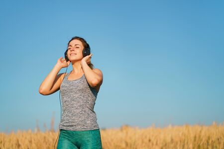 Sporty woman enjoy music in earphones at workout