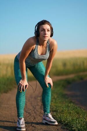 Fit sporty woman rest after jogging workout Stok Fotoğraf