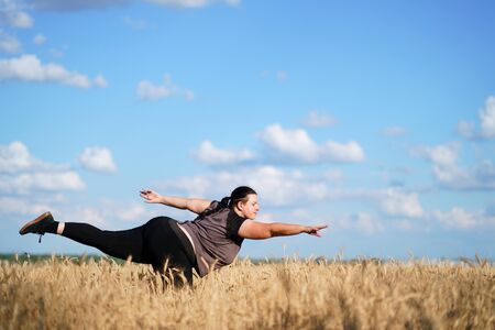 Overweight woman dancing. Body positive, freedom