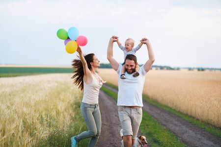 Daddy, mom and child having fun outdoors Stok Fotoğraf