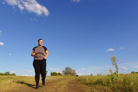 Overweight runner go jogging outdoors. Weight loss