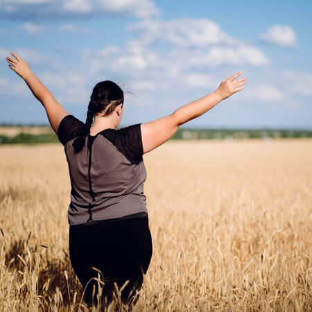 Excited woman celebrating success with arms up