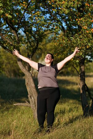 Happy excited woman celebrating success with arms up Stok Fotoğraf