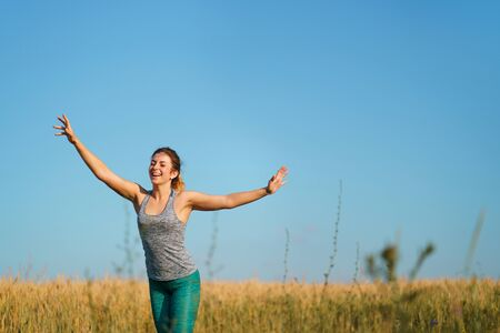 Happy runner raising arms expressing positive