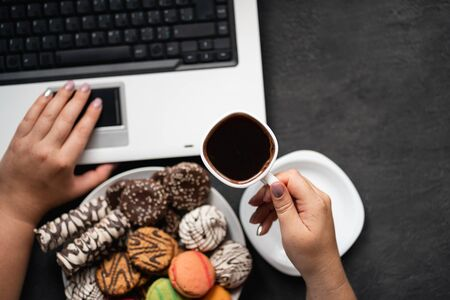 Unhealthy snacking, eating junk food at workplace