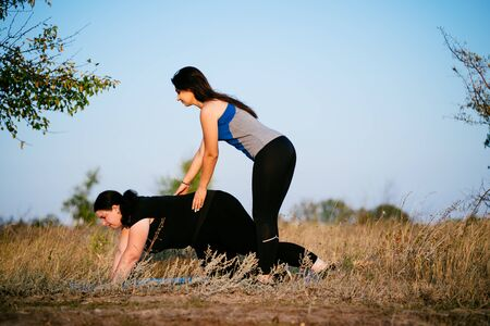 Personal trainer working with her client outdoors Stock fotó