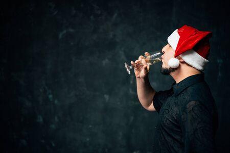 Happy man celebrating New Year drinking champagne