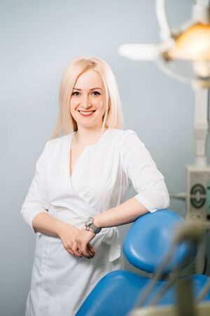 Portrait of female dentist standing at her office