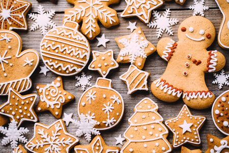 Christmas and New Year celebration traditions, festive food, kitchen background with homemade gingerbread cookies on wooden table