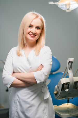Professional female dentist at clinic