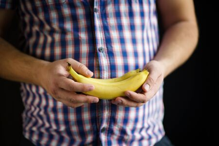 obesity prevention, vegetarian diet, conscious eating, nutrition choices, mindfulness and lifestyle. overweight man with bananas in hands