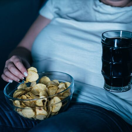 overeating, sedentary lifestyle, alcohol addiction Stock Photo