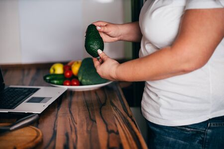 Overweight woman blogger recording cooking video Stock Photo