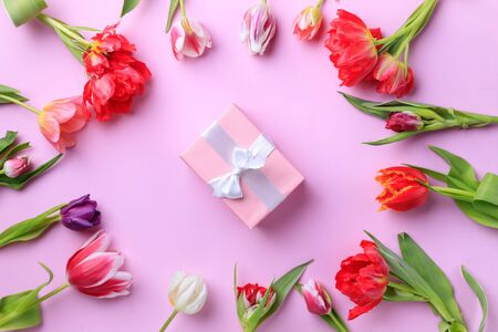 Spring creative holiday present with floral decor Stock Photo