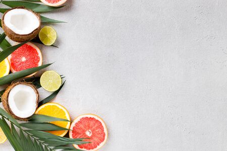 Summertime tropical background with exotic fruits