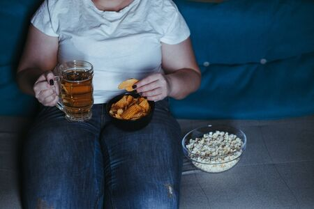 Woman overeating with late night snacks