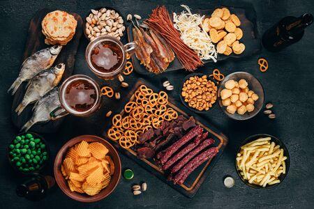 Set of appetizers, salty snacks and light beer Foto de archivo
