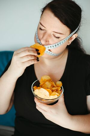 Obese woman with unhealthy food, eating disorder