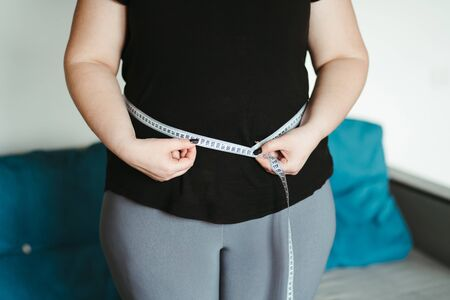 overweight, diet. fat woman with measuring tape Banco de Imagens