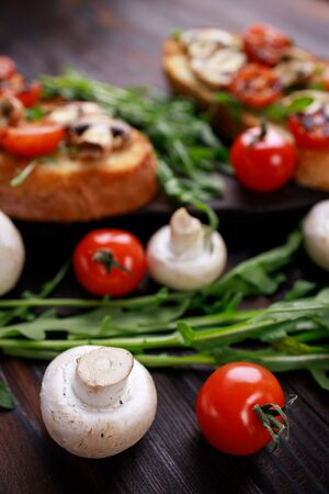 bruschettas with grilled vegetables and arugula.