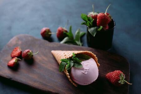 Strawberry ice cream cone close up, copy space