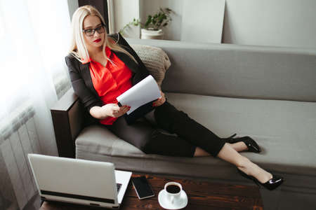 Woman working from home online using laptop