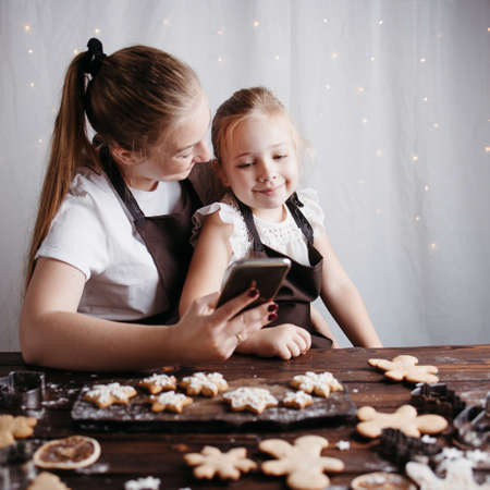 Mother and daughter with gingerbread cookies