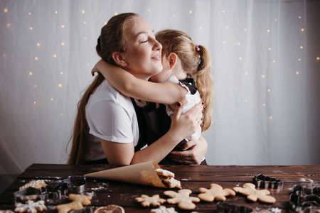 Christmas and New Year holidays, family weekend activities. Mother and daughter hugging sharing Christmas time together