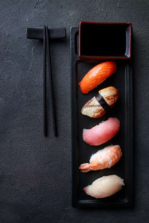 Seafood delicatessen nigiri sushi on plate. Different gourmet snacks. Luxury lifestyle, expensive food, restaurant menu