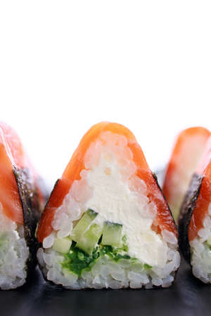 Seafood delicatessen salmon sushi rolls on plate. Seafood delicatessen salmon sushi rolls on plate. Food background, goods delivery, Japanese cuisine restaurant menu mockup, copy space