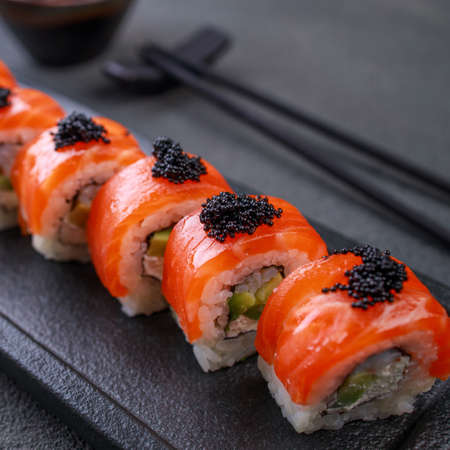 Seafood delicatessen salmon sushi rolls on plate. Gourmet snacks. Luxury lifestyle, Japanese food art, expensive meals, restaurant menu