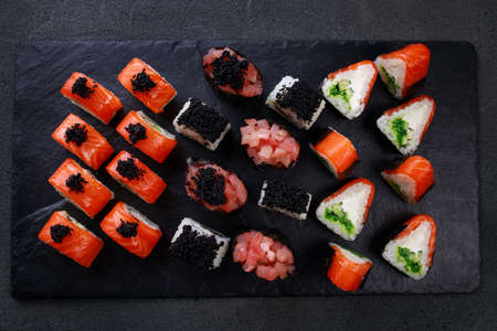 Seafood delicatessen various sushi rolls on plate. Gourmet snacks. Luxury lifestyle, Japanese food art, expensive meals, restaurant menu Foto de archivo