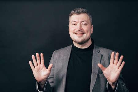 Business man showing no problem gesture