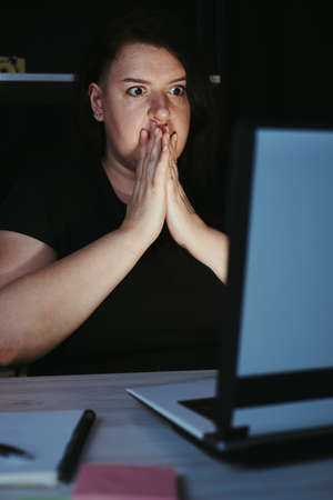 Shocked stressed woman mistaken at night work Фото со стока