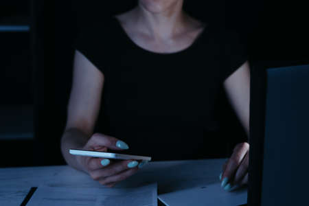 Woman writing the text message late in the night