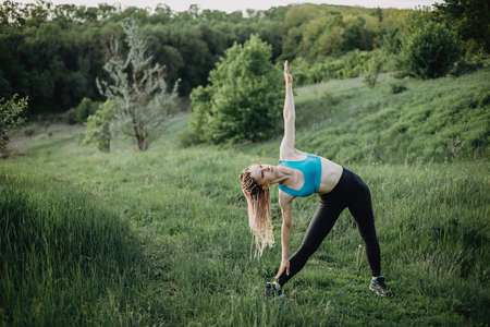 Sporty fit woman doing morning workout outdoors Stock Photo